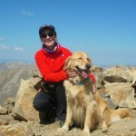 Shannon Patrizio and golden retriever Sunny at the top of Mt. Elbert